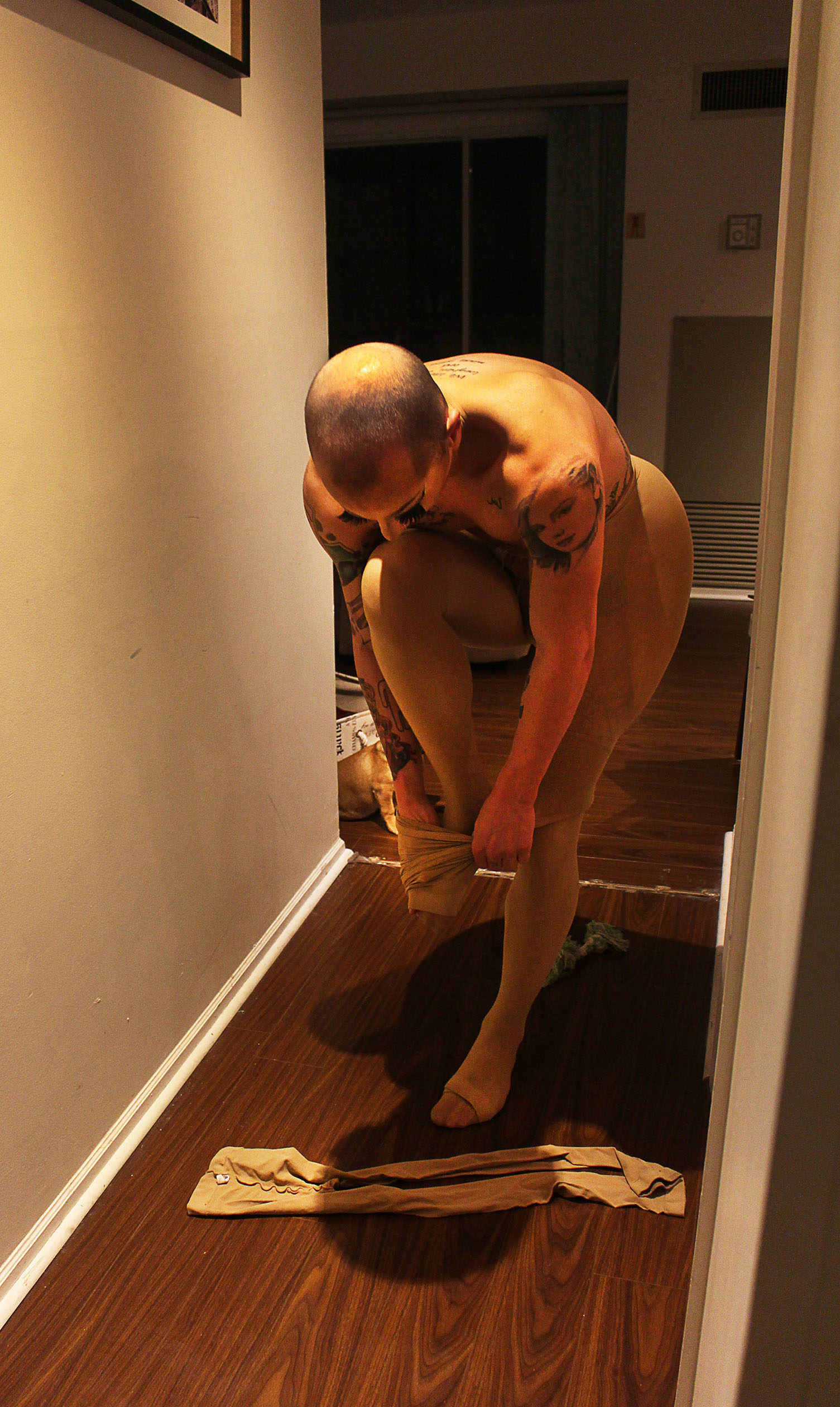 Matty Cameron getting dressed at home, in preparation for a performance.